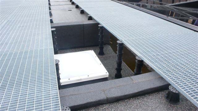 HDG-Grating-Panels-and-Buzon-Pedestals-Span-Uneven-Floors-and-Trenches